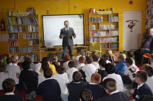 Minister Cannon speaking in the library